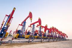 Oil pumps working at oilfiled Stock Photos