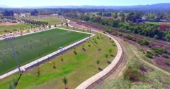 Stock Video Footage of 4K, Aerial view of Soccer football game  on a green grass field