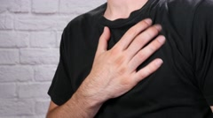 4K Chest Pain Young Man Closeup Stock Footage