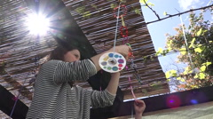Jewish woman and child decorating Sukkah for the Jewish festival of Sukkot Stock Footage