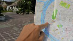 Tourist with Map Looking around in Wat Pho Wat Pho in Bangkok (Temple Of Reclini Stock Footage