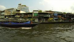 Stock Video Footage of Public transport boats in old town Bangkok passing by. Speed up.