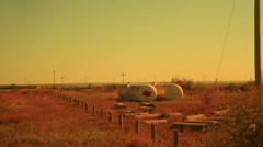 Abandoned gas tanks outside abandonment Stock Footage