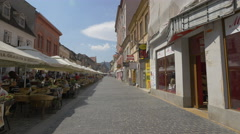Relaxing on Republicii street, at an outdoor restaurant, Brasov Stock Footage