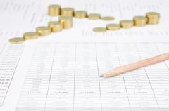 Pencil have blur step of gold coins on finance account Stock Photos