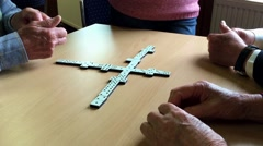 Group of People playing dominoes. Stock Footage