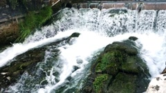 Water way in the city with small dam. Stock Footage