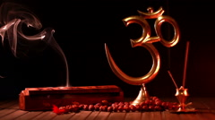 Om symbol and incense stick - stock footage