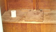 Gross toilet outhouse wooden primitive Stock Footage