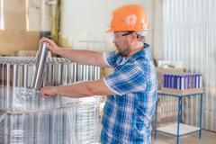 Worker in safety helmet at the storage Stock Photos
