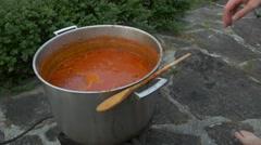 Man stirs tomato sauce Stock Footage