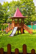 Kid's playground outdoors tower green lawn children Stock Photos