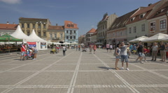 Children driving pedal karts and electric jeep in the Council Square, Brasov Stock Footage