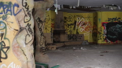 Stock Video Footage of Graffiti of fish inside a rundown abandoned building, pan right