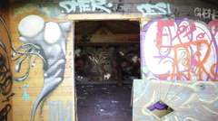 Colorful graffiti in an abandoned wooden house - stock footage