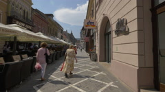 Republicii street with stores and outdoor restaurants, Brasov Stock Footage