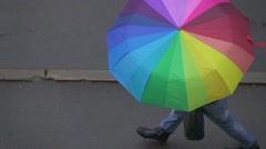 Rainy day in city streets people walking under umbrella, slow motion overhead vi Stock Footage