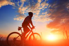 mountain bicycle rider on the hill - stock photo