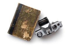Vintage 35mm film camera and old book Stock Photos