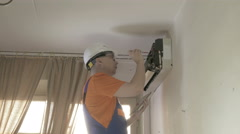 Service man to clean air conditioner Stock Footage