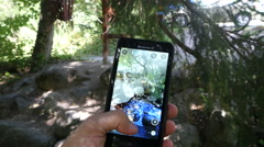 Stock Video Footage of Making photo via cell phone of a stones and mountain river nature in Bulgaria