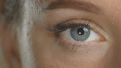 Girl opens beutiful blue eye, macro - stock footage