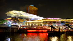 Night scene Clarke quay boat in Singapore river Stock Footage