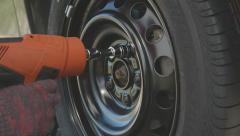Tightening the screws on the wheel Stock Footage