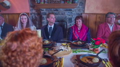 Guest is waiting for waiter who bringing the last food on table  - stock footage