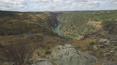 Flying over rock and approaching the edge of canyon Stock Footage