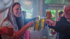Wife is toasting with relatives in restaurant  - stock footage
