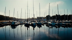 Aerial drone shot of sailing boats in port Stock Footage