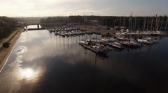 Aerial drone shot of sailing yachts in port Arkistovideo