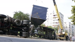 Overturned truck drawing machine - stock footage