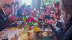 Everybody enjoy in traditional food in traditional restaurant Stock Footage