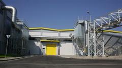 Waste plant blue sky pan Stock Footage