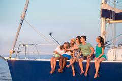 Youth makes selfie on a yacht. Stock Photos