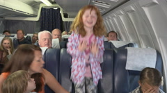Naughty child on plane will not sit down Stock Footage