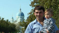 Son with his father in the background of the church Stock Footage