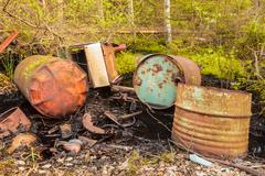Rusted waste barrels in a forest Stock Photos