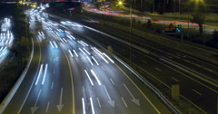Car damaged in the middle of the traffic.Time Lapse - Long exposure - 4K Stock Footage