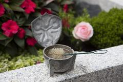 Holy water shell at the grave - stock photo