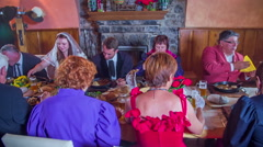 The honeymooners and relatives eating the home made food in restaurant - stock footage