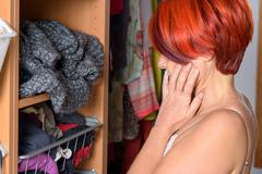 Desperate Middle Aged Woman in front of her wardrobe Stock Photos