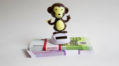 Toy monkey with money Stock Footage