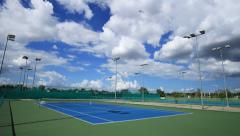 4k Time-lapse of outdoor empty tennis court with blue sky Stock Footage