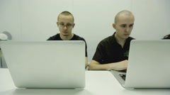 Serious users are working hard for laptops Stock Footage
