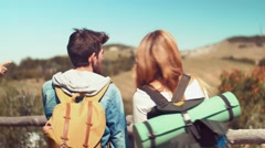 Handheld shot of hikers friends in front of mountain Stock Footage