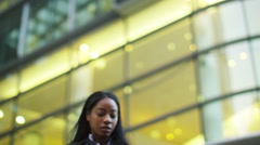 4K Beautiful young woman on city street, using mobile phone for navigation Stock Footage