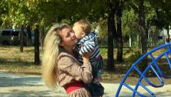 A woman with a baby in her arms Stock Footage